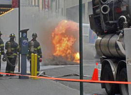 Firemen acting against manhole fire at the city
